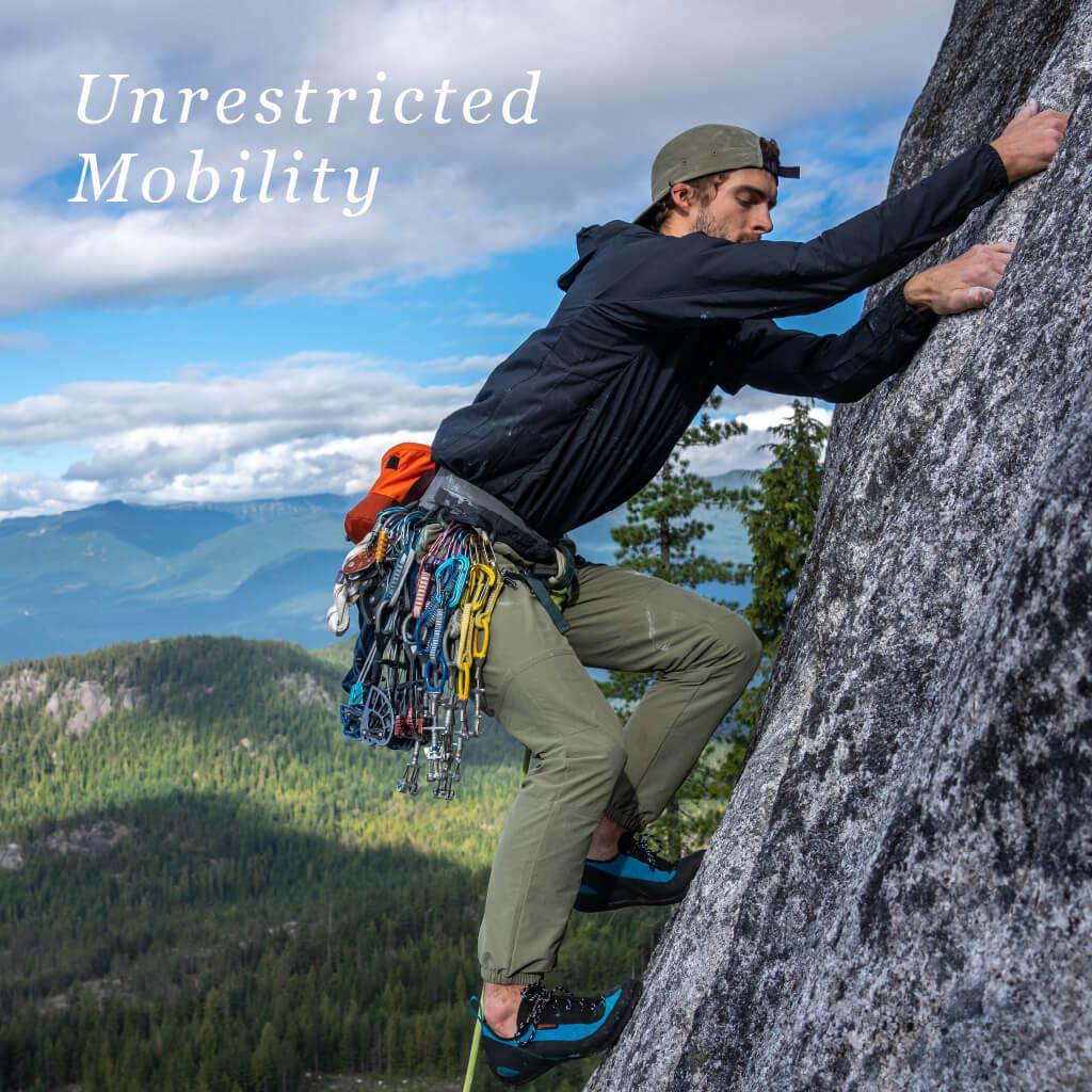 Boulder Range, Unrestricted Mobility - Man rock climbing, wearing macpac Boulder range